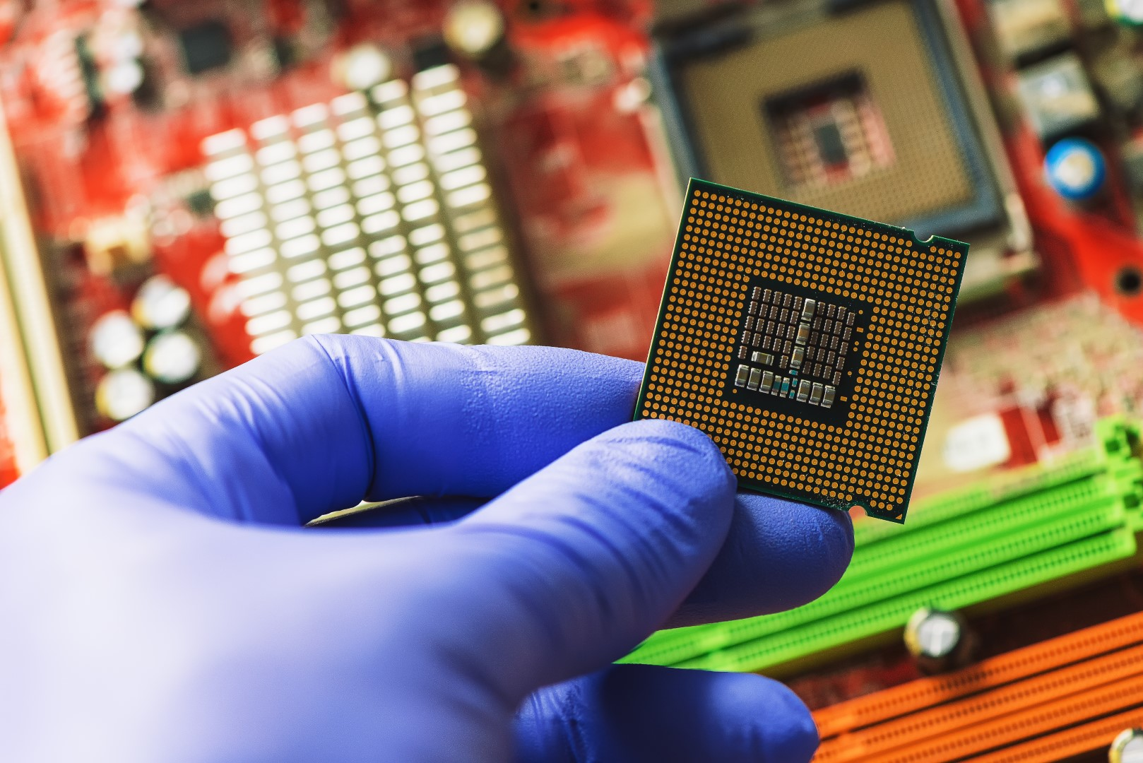 Computer forensics investigator installing old cpu